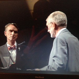Bill Nye listens carefully as Ken Ham makes the claim that the Bible is a better source of fact than material science
